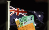 A pay packet in front of the Australian flag.