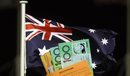 A pay envelope in front of the Australian flag.