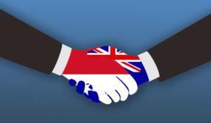 Hands representing Australia and Indonesia shake.
