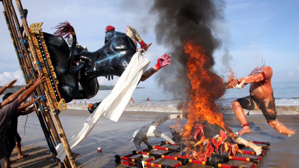 Symbols of evil spirits known as Ogoh-ogoh are cremated during an event on Nyepi eve in Bali.