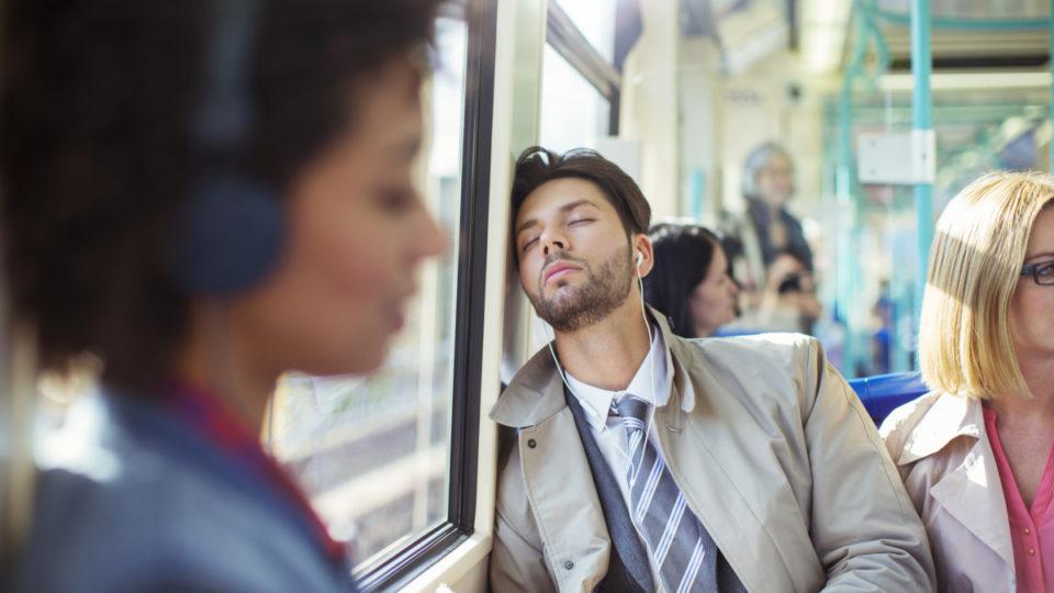 man sleeping on bus