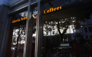 A Gloria Jeans coffee shop storefront.