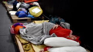 Homeless man sleeping in Sydney's CBD