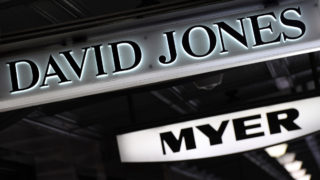 Signs for David Jones and Myer hang from an awning.