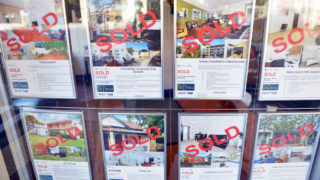 A picture of housing advertisements which have the words sold on them