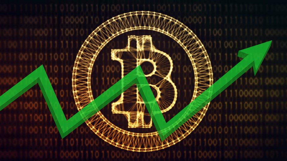 A bitcoin logo behind a graph.