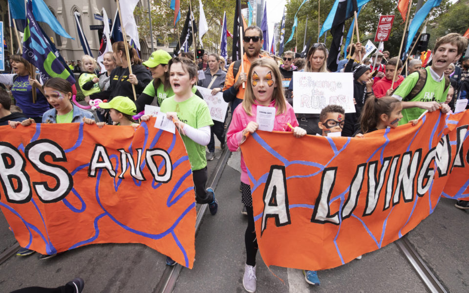 Premier joins 100,000 workers on union march
