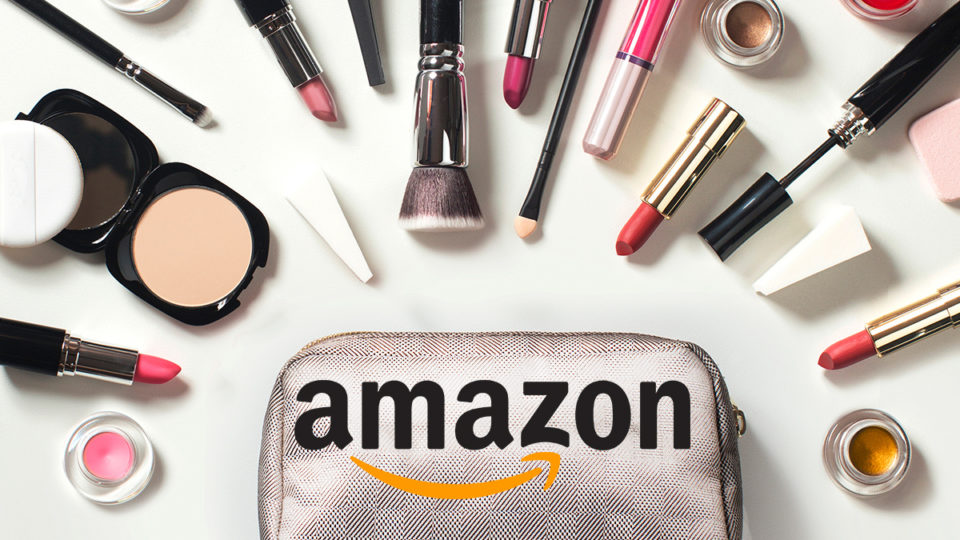 A make-up bag branded with the Amazon logo, surrounded by cosmetics.