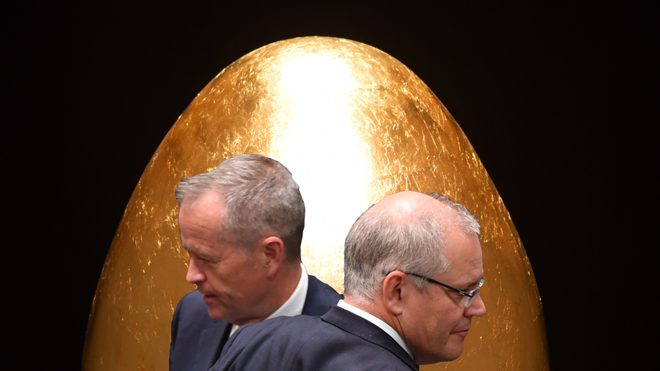 Scott Morrison and Bill Shorten face off in front of a giant golden egg.