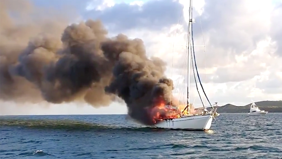 Two yachties and their dog have a lucky escape from burning boat