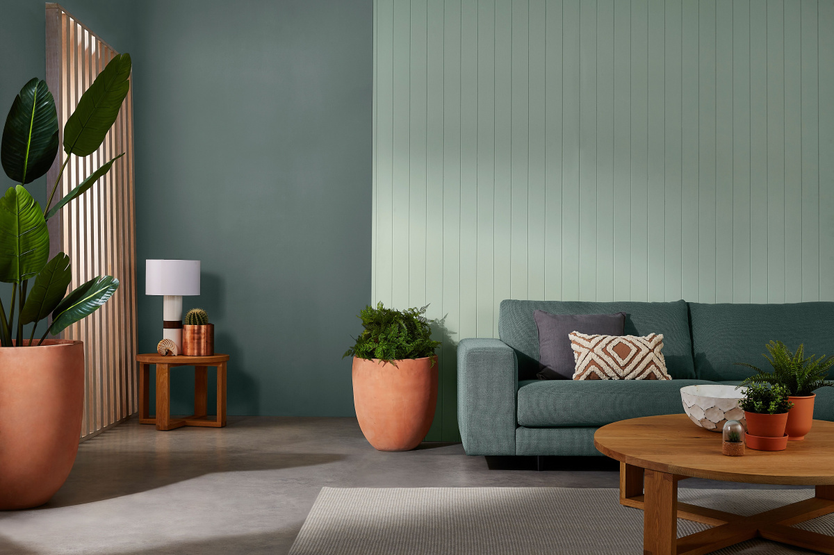 A photo of a green lounge room