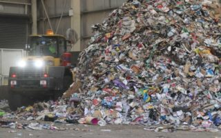 Recycling piles up in an Adelaide facility.