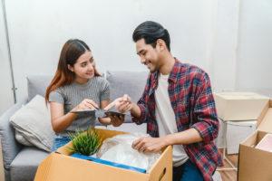 A couple unpacking a box