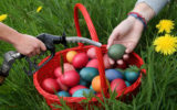 A basket of Easter eggs and a fuel pump.
