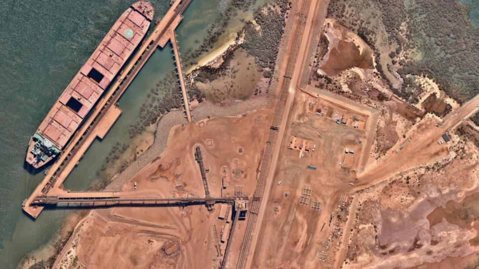 slow economy buoyed by iron ore prices