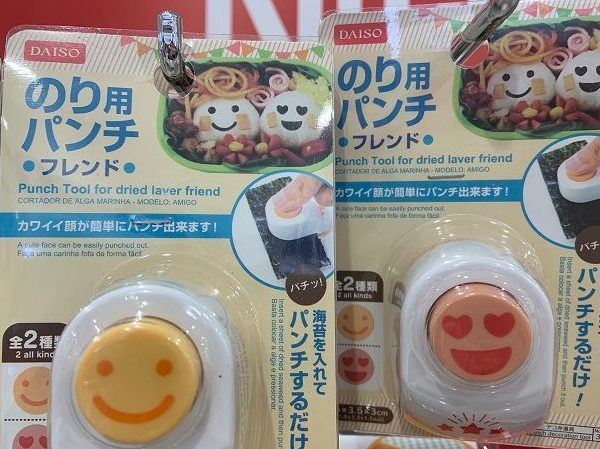 Smiling faces on plastic tools used to make Japanese rice balls