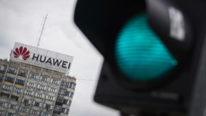 A building with a large Huawei sign on top.