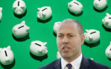 Josh Frydenberg with piggy banks.