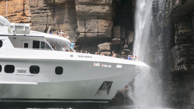 Up close and personal with a Kimberley waterfall – without leaving the ship.