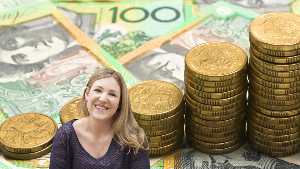Cyan Ta'eed in front of piles of Australian currency.