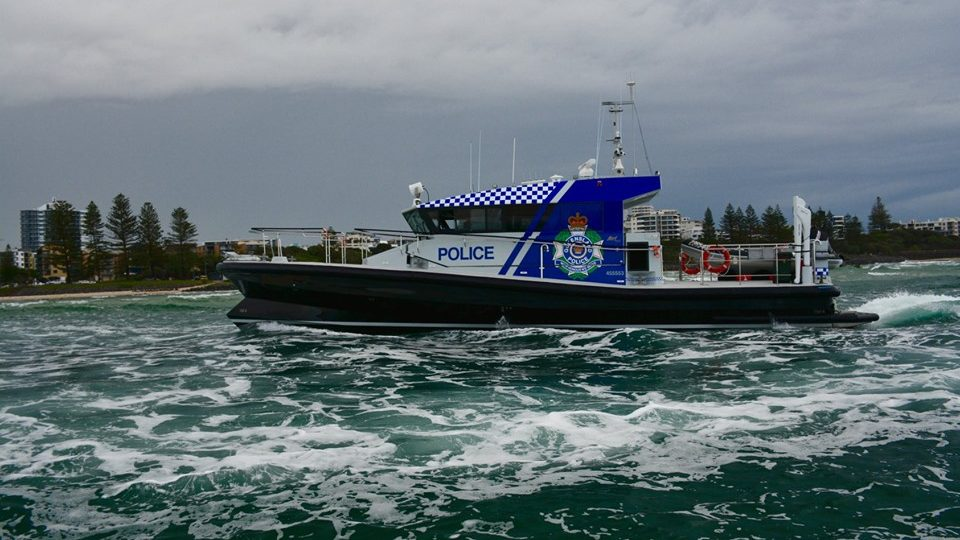 Two men and a child missing after boat capsize in Queensland