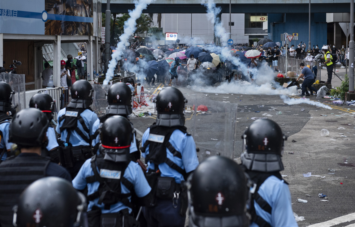 Protesters scrambled in the chaos as some shouted 'please don't go Hong Kong needs you.' Photo: Getty