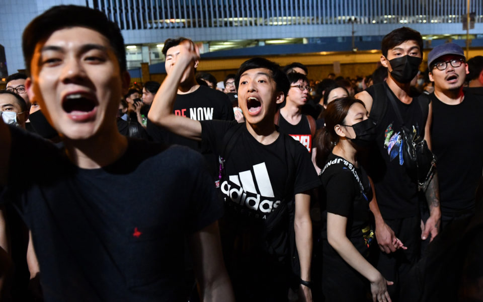 hong kong leader issues apology as massive protest resumes