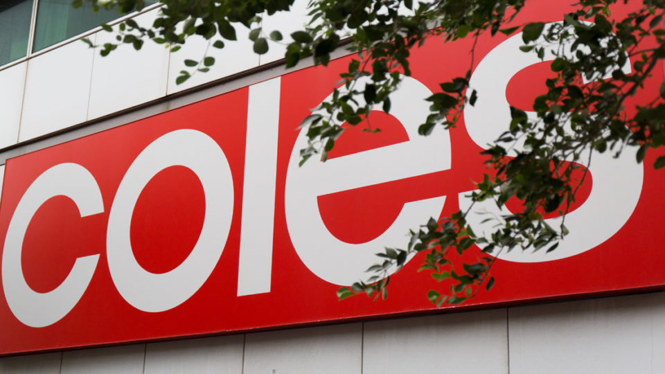 A sign adorning the front of a Coles supermarket,