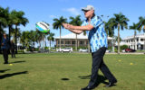 Scott Morrison passes a football on a previous trip to the Island nation.