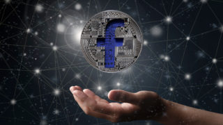 A digital coin bearing the iconic Facebook F.