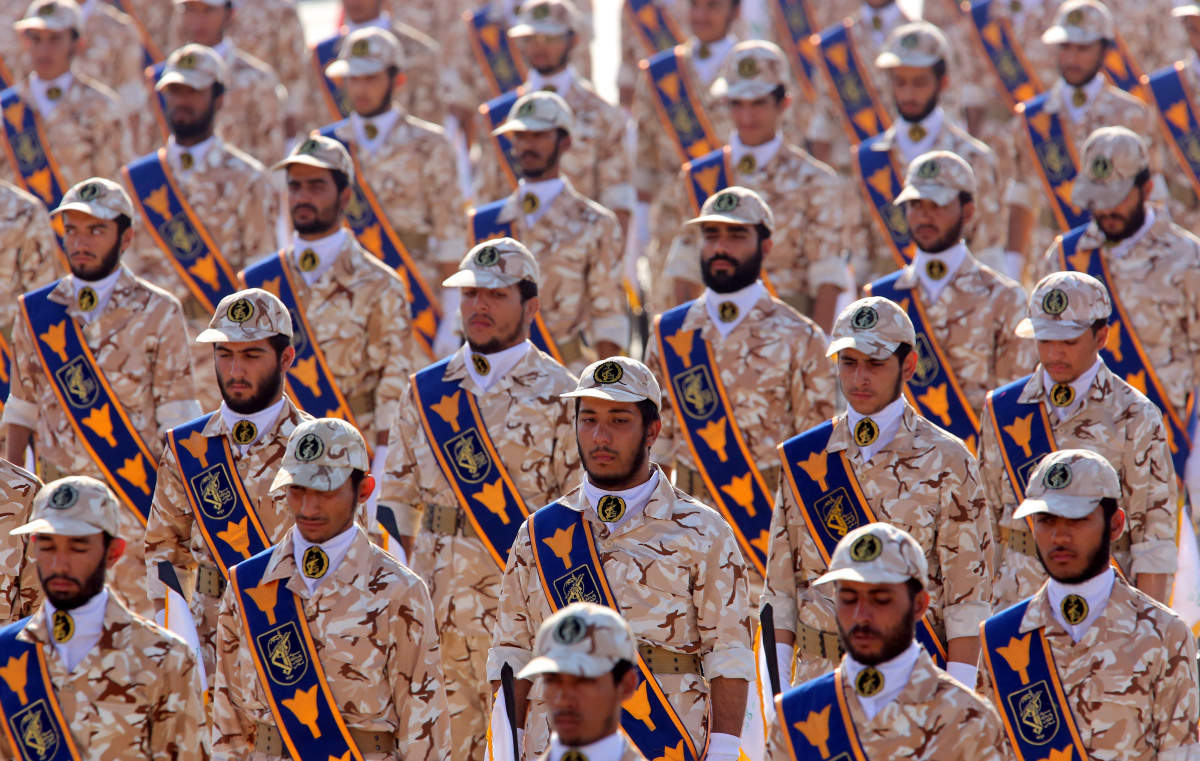 Iranian revolutionary guard soldiers march during an annual military parade.