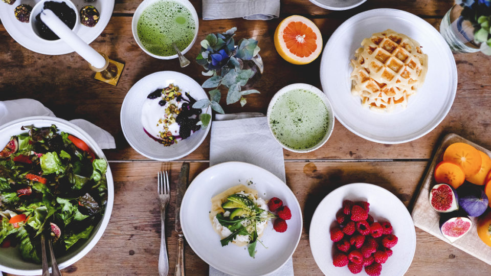 A table covered in a selection of brunch foods.