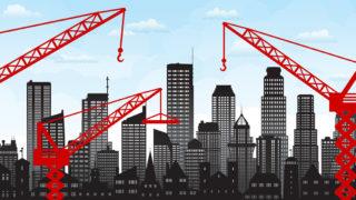 Cartoon cranes on a city skyline.