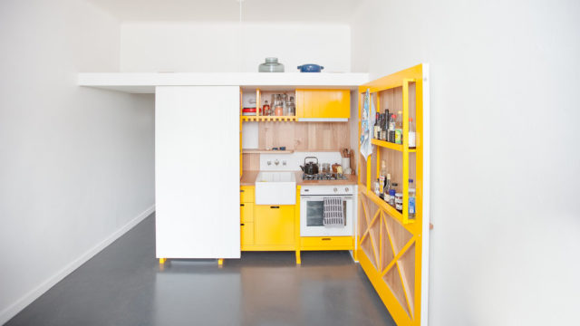 Architect Nicholas Agius used a fold-out kitchen bench-top to maximise space in his 23-square-metre Fitzroy apartment.