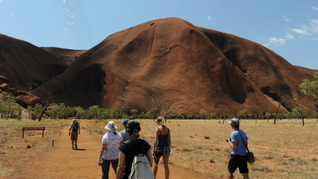 Thousands of tourists race to beat Uluru climb ban
