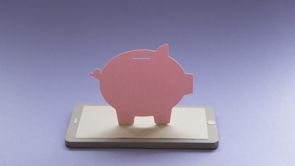 A piggy bank on a phone.
