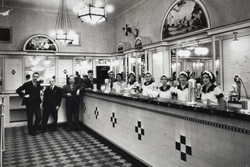 Black and white photo of Australia's first milk bar in Sydney.