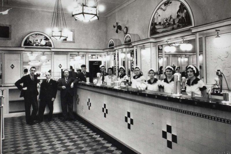 Black and white photo of Australia's first milk bar in Sydney.