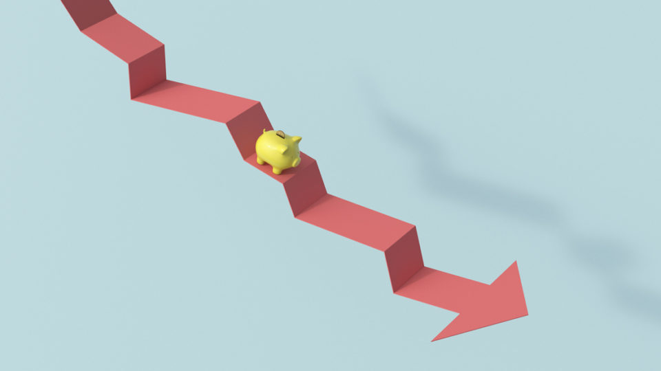 A piggy bank climbing a down arrow.