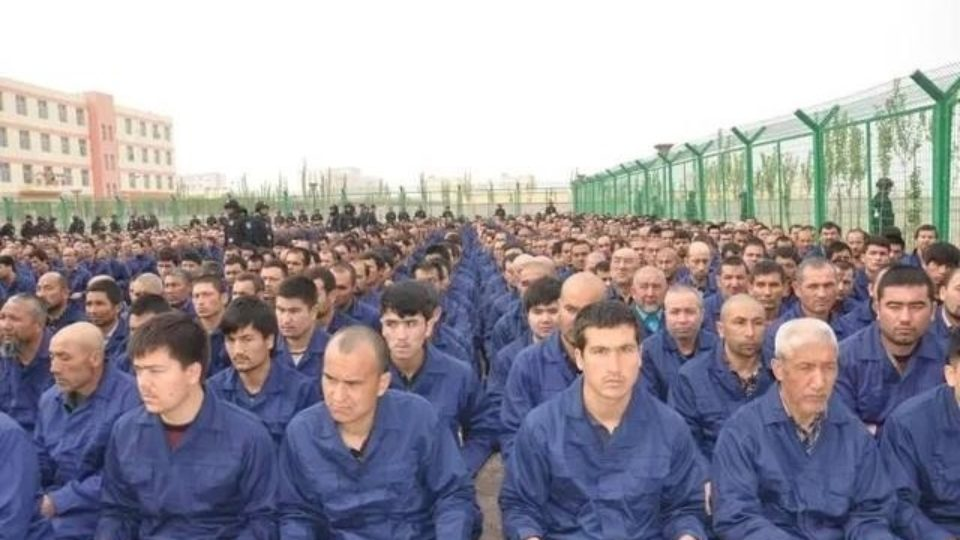 "Detainees in a Xinjiang Re-education Camp listening to ""de-radicalisation"" talks last year. Photo: Chinese TV"