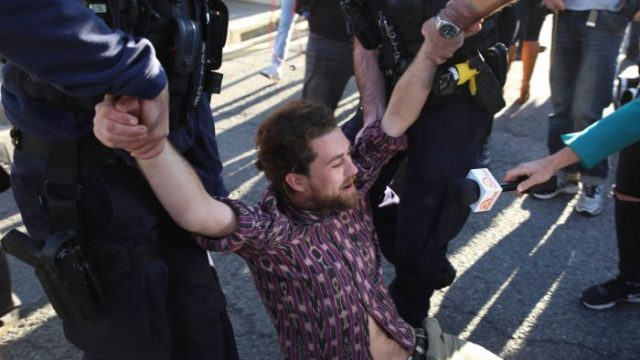 56 climate protesters arrested after Brisbane CBD chaos