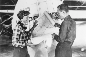Ms. Earhart and navigator Fred Noonan, holding a map that shows the route of their last flight. Photo: Getty