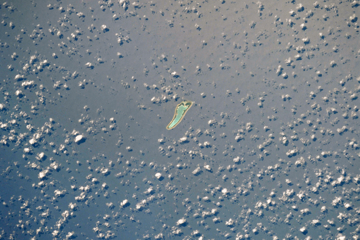 A satellite image of Nikumaroro atoll. It is a mere 4.7 miles long and 1.6 miles wide. Photo: NASA