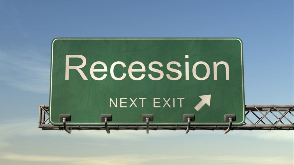 A street sign indicating an upcoming recession.