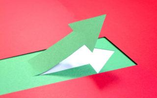 A green arrow ascending