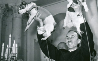 Oleg Gazenko, director of Russia's Institute of Biomedical Problems, holds up Belka (right) and Strelka (left)
