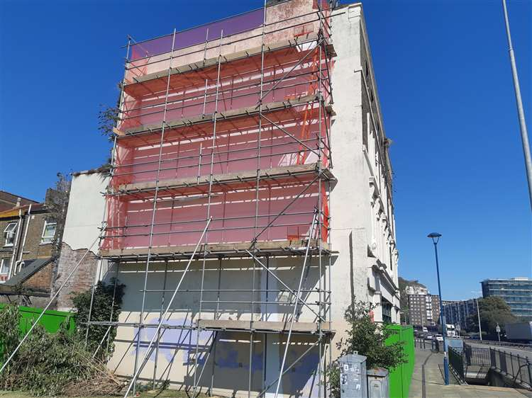 Over the weekend a four-tier scaffolding was erected beside the mural. Photo: Twitter