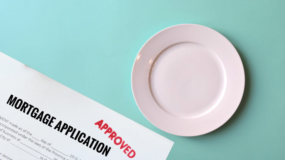 An empty plate next to an approved mortgage form.