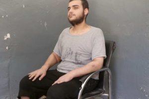 Hamza Elbaf sitting in a chair.
