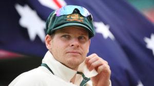 Steve Smith in front of the Australian flag.